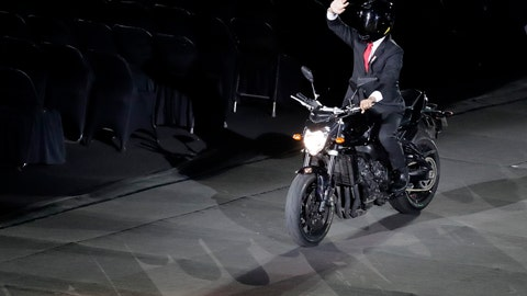 <p>               Indonesian President Joko Widodo waves as he arrives on a motorbike to the opening ceremony for the 18th Asian Games in the Gelora Bung Karno Stadium, Jakarta, Indonesia, Saturday, Aug. 18, 2018. (AP Photo/Lee Jin-man)             </p>