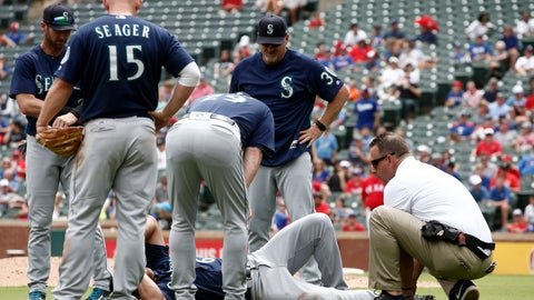 <p>               Seattle Mariners pitcher Mariners Sam Tuivailala receives assistance after getting injured against the Texas Rangers as third baseman Kyle Seager (15) manager Scott Servais (29) and pitching coach Mel Stottlemyre (30) look on during the sixth inning of a baseball game Wednesday, Aug. 8, 2018, in Arlington, Texas. (AP Photo/Mike Stone)             </p>