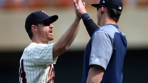 <p>               Minnesota Twins' Logan Forsythe, left, celebrates the Twins' 6-4 win over the Pittsburgh Pirates in a baseball game Wednesday, Aug. 15, 2018, in Minneapolis. Forsythe, a recent addition to the team, had three RBIs. (AP Photo/Jim Mone)             </p>