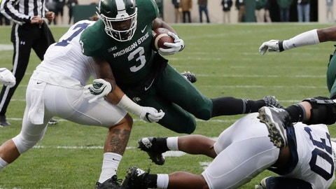 <p>               File- This Nov. 4, 2017, file photo shows Michigan State running back LJ Scott (3) being  tackled by Penn State linebacker Koa Farmer, left, during the first half of an NCAA college football game in East Lansing, Mich. Scott enters his senior season with some impressive career rushing stats: 2,591 yards and 25 touchdowns. A good final season could put him in the top four on the school's career list in both categories but he also has room for improvement. He was part of a team-wide fumbling problem that plagued the Spartans last year. (AP Photo/Carlos Osorio, File)             </p>