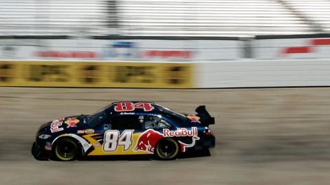BRISTOL, TN - MARCH 23:  AJ Allmendinger, driver of the #84 Red Bull Toyota, drives during practice for the NASCAR Nextel Cup Series Food City 500 at Bristol Motor Speedway on March 23, 2007 in Bristol, Tennessee.  (Photo by Jason Smith/Getty Images for NASCAR)