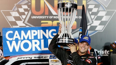 BROOKLYN, MI - AUGUST 11: Brett Moffitt, driver of the #16 Hino Toyota, takes the checkered flag before Johnny Sauter, driver of the #21 ISM Connect Chevrolet, during the NASCAR Camping World Truck Series Corrigan Oil 200 at Michigan International Speedway on August 11, 2018 in Brooklyn, Michigan.  (Photo by Jerry Markland/Getty Images)