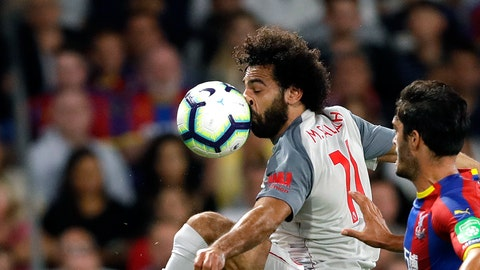 <p>               Liverpool's Mohamed Salah, left, duels for the ball with Crystal Palace's James Tomkins during the English Premier League soccer match between Crystal Palace and Liverpool at Selhurst Park stadium in London, Monday, Aug. 20, 2018. (AP Photo/Kirsty Wigglesworth)             </p>