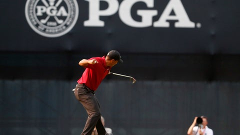<p>               FILE - In this Aug. 12, 2018 file photo Tiger Woods celebrates his birdie putt on the 18th green during the final round of the PGA Championship golf tournament at Bellerive Country Club in St. Louis. Woods is being treated as big now as when he was at his peak. (AP Photo/Jeff Roberson, file)             </p>