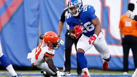 <p>               New York Giants' Saquon Barkley (26) rushes past Cleveland Browns' Denzel Ward (21) during the first half of a preseason NFL football game Thursday, Aug. 9, 2018, in East Rutherford, N.J. (AP Photo/Adam Hunger)             </p>