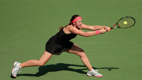 <p>               Jelena Ostapenko, of Latvia, returns to Andrea Petkovic, of Germany, during the first round of the U.S. Open tennis tournament, Tuesday, Aug. 28, 2018, in New York. (AP Photo/Andres Kudacki)             </p>
