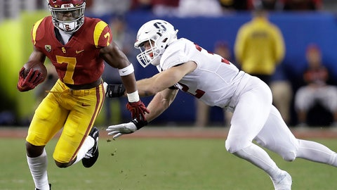 <p>               FILE - In this Dec. 1, 2017, file photo, Southern California running back Stephen Carr (7) runs against Stanford linebacker Joey Alfieri (32) during the first half of the Pac-12 Conference championship NCAA college football game in Santa Clara, Calif. (AP Photo/Marcio Jose Sanchez, File)             </p>
