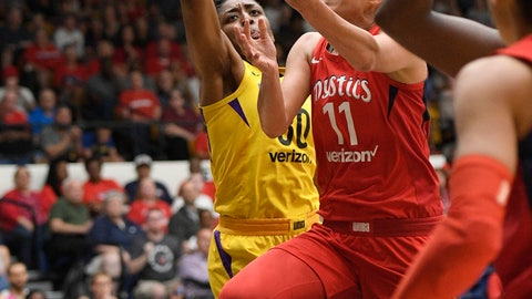 <p>               Washington Mystics guard Elena Delle Donne (11) goes to the basket against Los Angeles Sparks forward Nneka Ogwumike, left, during the first half of a single-elimination WNBA basketball playoff game, Thursday, Aug. 23, 2018, in Washington. (AP Photo/Nick Wass)             </p>