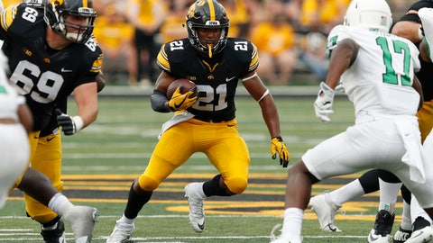 <p>               FILE - In this Sept. 16, 2017, file photo, Iowa running back Ivory Kelly-Martin (21) runs from North Texas linebacker Joe Ozougwu, right, during the second half of an NCAA college football game, in Iowa City, Iowa. Sophomore Ivory Kelly-Martin will likely start the season as Iowa's top running back, according to offensive coordinator Brian Ferentz. The move could be categorized as a mild surprise given that fellow sophomore Toren Young was listed ahead of Kelly-Martin on a depth chart released earlier in fall camp. But Kelly-Martin, who appeared to be slotted as an option on third downs and in the return game, has shown Iowa's coaches that he has the potential to an every down back in their system. The Hawkeyes (8-5 in 2017) host Northern Illinois on Sept. 1. (AP Photo/Charlie Neibergall, FIle)             </p>