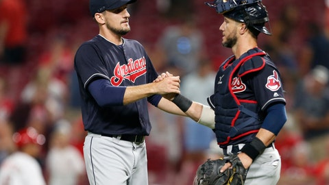 <p>               Cleveland Indians relief pitcher Dan Otero, left, and catcher Yan Gomes celebrate the team's 10-3 win over the Cincinnati Reds in a baseball game, Monday, Aug. 13, 2018, in Cincinnati. (AP Photo/Gary Landers)             </p>
