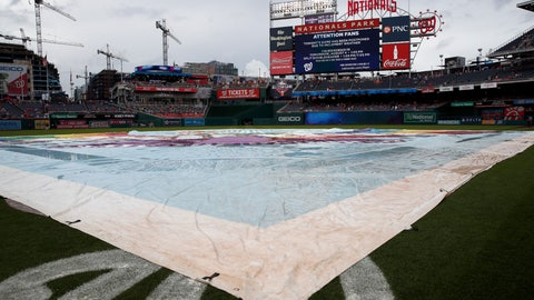 <p>               The tarp is on the field as it is announced that the baseball game between the Washington Nationals and the Cincinnati Reds is postponed at Nationals Park, Friday, Aug. 3, 2018, in Washington. The game was rescheduled for Saturday. (AP Photo/Alex Brandon)             </p>