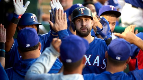<p>               Texas Rangers' Joey Gallo is congratulated after hitting a two-run home run against the Baltimore Orioles during the fourth inning of a baseball game in Arlington, Texas, Saturday, Aug. 4, 2018. (AP Photo/Cooper Neill)             </p>