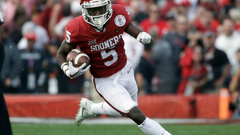 """<p>               FILE - In this Jan. 1, 2018, file photo, Oklahoma wide receiver Marquise Brown carries the ball during the Rose Bowl NCAA college football game against Georgia, in Pasadena, Calif. Marquise """"Hollywood"""" Brown made his mark last season as a speedster. Now that he's added tools and size in the offseason, he expects to be even more dangerous. He gained more than 1,000 yards receiving last season, and now, the junior is looking for more. He'll be a marked man when the seventh-ranked Sooners open on Sept. 1 against Florida Atlantic. (AP Photo/Jae C. Hong)             </p>"""