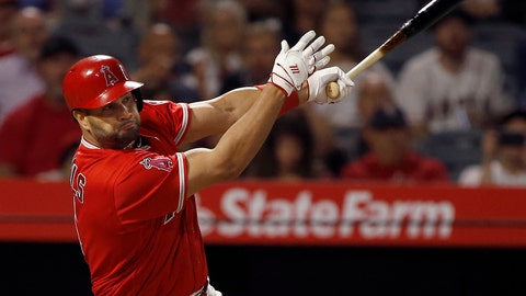 <p>               FILE - In this Monday, June 4, 2018 file photo, Los Angeles Angels' Albert Pujols hits an RBI single to score Mike Trout against the Kansas City Royals during the sixth inning of a baseball game in Anaheim, Calif. os Angeles Angels slugger Albert Pujols is likely to miss the rest of the season after undergoing surgery on his left knee. The Angels announced Pujols' arthroscopic knee surgery Wednesday, Aug. 29, 2018. (AP Photo/Alex Gallardo, File)             </p>
