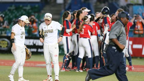 <p>               Japan's players, in white jersey, react as U.S. team members, in red jersey, celebrate after Women's Softball World Championship game Saturday Aug. 11, 2018 in Makuhari, east of Tokyo. United States to a 4-3 win over Japan and into the final of the women's world softball championship. (Kyodo News via AP)             </p>