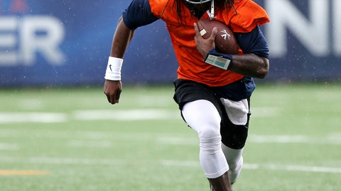 <p>               FILE - In this March 27, 2018, file photo, Virginia's Bryce Perkins runs the ball during the NCAA college football team's practice in Charlottesville, Va. Perkins has been praised as the answer at quarterback for Virginia. He enters his first week of game preparation of the Power Five level as the Cavaliers prepare to open against Richmond on Saturday. (Zach Wajsgras/The Daily Progress via AP, File)             </p>
