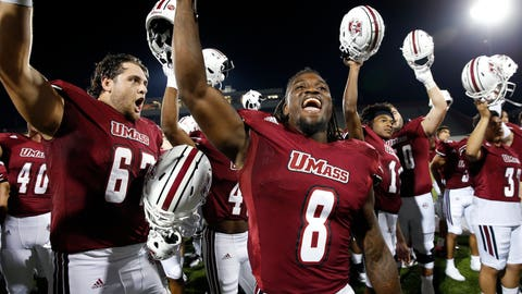<p>               Massachusetts running back Marquis Young (8) celebrates with teammates after defeating Duquesne in an NCAA college football game in Amherst, Mass., Saturday, Aug. 25, 2018. (AP Photo/Michael Dwyer)             </p>