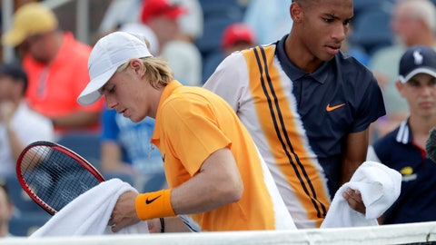<p>               Denis Shapovalov, left, of Canada, passes in front of Felix Auger-Aliassime, also of Canada, during their first-round match at the U.S. Open tennis tournament, Monday, Aug. 27, 2018, in New York. (AP Photo/Julio Cortez)             </p>