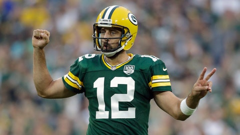 Aaron Rodgers reacts after signing the largest contract in National Football League history