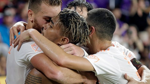 <p>               Atlanta United's Josef Martinez, second from left, is surrounded by teammates after scoring a goal against Orlando City during the second half of an MLS soccer match Friday, Aug. 24, 2018, in Orlando, Fla. (AP Photo/John Raoux)             </p>