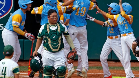 <p>               South Korea catcher Gi Jeong Kim, walks to the mound as Honolulu, Hawaii's Mana Lau Kong (19) is greeted by teammates after hitting the first pitch of the baseball game from South Korea's Yeong Hyeon Kim, lower left, for a solo home run in the first inning of the Little League World Series Championship in South Williamsport, Pa., Sunday, Aug. 26, 2018. (AP Photo/Tom E. Puskar).             </p>