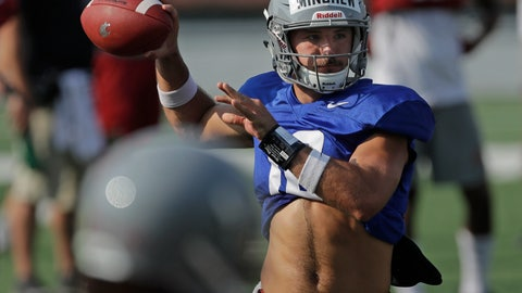<p>               Washington State quarterback Gardner Minshew passes during NCAA college football practice, Thursday, Aug. 16, 2018, in Pullman, Wash. Minshew is one of three quarterbacks competing for the starting job. (AP Photo/Ted S. Warren)             </p>