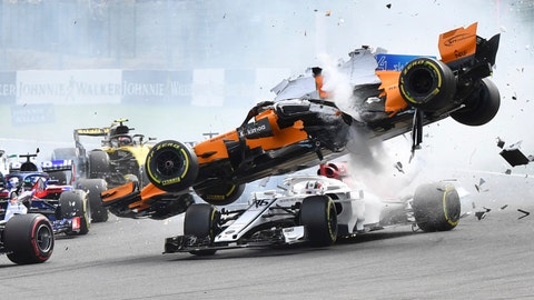 Mclaren driver Fernando Alonso of Spain top goes over the top of Sauber driver Charles Leclerc of Monaco as they are involved in a crash at the start of the Belgian Formula One Grand Prix in Spa-Francorchamps Belgium Sunday Aug. 26 20