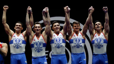<p>               Members of the Russian team hold up their gold medals after placing first in the men's artistic gymnastics team finals at the European Championships in Glasgow, Scotland, Saturday, Aug. 11, 2018. From left, Nikita Nagornyy, David Belyavskiy, Nikolai Kuksenkov, Dmitrii Lankin and Artur Dalaloyan. (AP Photo/Darko Bandic)             </p>