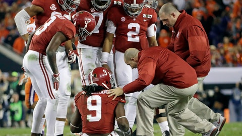 <p>               FILE - In this Jan. 9, 2017, file photo, Alabama's Bo Scarbrough is looked at after being hurt during the second half of the NCAA college football playoff championship game against Clemson in Tampa, Fla. Player privacy laws currently stand in the way of regular in-depth NCAA football injury reports. Yet a mandated reporting system has been proposed. The Supreme Court's decision to allow the legalization of sports gambling up to the states sparked the idea. (AP Photo/David J. Phillip, File)             </p>