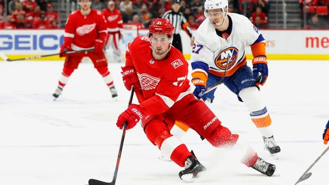 <p>               File-This April 7, 2018, file photo shows Detroit Red Wings center Dylan Larkin (71) skating past New York Islanders left wing Anders Lee (27) in the second period of an NHL hockey game in Detroit. The Detroit Red Wings have re-signed Larkin to a $30.5 million, five-year contract. The team announced the deal with the 22-year-old center on Friday. Larkin was a restricted free agent. He led the team with a career-high 63 points and was third with 16 goals last season. He has 56 goals and 140 points over three NHL seasons, playing in at least 80 games each year. (AP Photo/Paul Sancya, File)             </p>