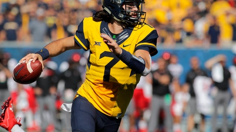 <p>               FILE - In this Oct. 14, 2017, file photo, West Virginia quarterback Will Grier (7) looks to pass against Texas Tech during an NCAA college football game in Morgantown, W.Va. While the Sooners are still the preseason favorite again, there are also high expectations for Grier, the preseason Big 12 offensive player of the year who threw 34 touchdowns and 3,490 yards in his injury-shortened WVU debut.(AP Photo/Raymond Thompson, File)             </p>