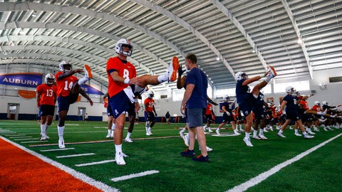 <p>               Auburn quarterback Jarrett Stidham (8) stretches with fellow players during NCAA college football practice, Friday, Aug. 3, 2018, in Auburn, Ala. (AP Photo/Butch Dill)             </p>