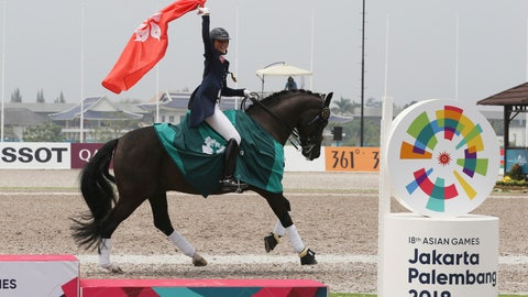 <p>               Hong Kong's Jacqueline Wing Ying Siu celebrates after winning gold medal during dressage individual intermediate I freestyle equestrian at the 18th Asian Games in Jakarta, Indonesia, Thursday, Aug. 23, 2018. (AP Photo/Achmad Ibrahim)             </p>