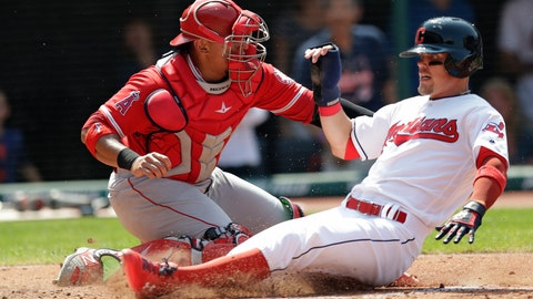<p>               Cleveland Indians' Brandon Guyer, right, slides safely into home plate as Los Angeles Angels' Jose Briceno, left, cannot make the tag in the sixth inning of a baseball game, Sunday, Aug. 5, 2018, in Cleveland. (AP Photo/Tony Dejak)             </p>