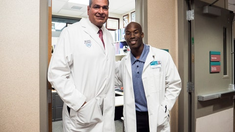 <p>               In this June 28, 2018 photo provided by Arizona State University Media Relations, Arizona State wide receiver Kyle Williams, right, poses with Dr. Anikar Chhabra, the team physician and director of sports medicine, at the Mayo Clinic in Scottsdale, Ariz. Summers are hardly a break for most college athletes, especially football players. Almost all take classes to lighten their loads in season. Still, many college football players work summer jobs and internships or do volunteer work. At Arizona State, receiver Kyle Williams is preparing to be a surgeon. (Arizona State University Media Relations via AP)             </p>