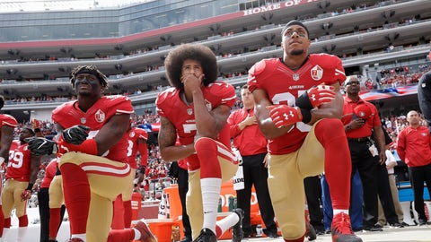 <p>               FILE - In this Oct. 2, 2016 file photo, from left, San Francisco 49ers outside linebacker Eli Harold, quarterback Colin Kaepernick and safety Eric Reid kneel during the national anthem before an NFL football game against the Dallas Cowboys in Santa Clara, Calif. An arbitrator is sending Kaepernick's grievance with the NFL to trial, denying the league's request to throw out the quarterback's claims that owners conspired to keep him out of the league because of his protests of social injustice.  (AP Photo/Marcio Jose Sanchez, File)             </p>