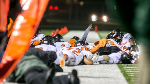 <p>               Members of the Freeport High School varsity football team drop to the ground for safety after gunfire rang out during the Freeport-Auburn season-opening high school football game on Friday, Aug. 24, 2018, in Rockford, Ill. The game came to an abrupt end when gunfire rang out and spectators fled. (Arturo Fernandez /Rockford Register Star via AP)             </p>