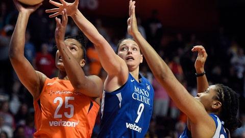 <p>               Connecticut Sun forward Alyssa Thomas (25) drives by Minnesota Lynx defenders Cecilia Zandalasini (9) and Tanisha Wright during the first half of a WNBA basketball game Friday, Aug. 17, 2018, in Uncasville, Conn. (Sean D. Elliot/The Day via AP)             </p>
