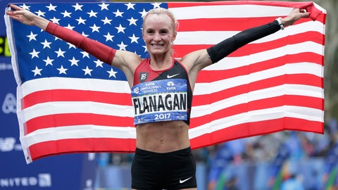 <p>               File-This Nov. 5, 2017, file photo shows Shalane Flanagan of the United States posing for pictures after crossing the finish line first in the women's division of the New York City Marathon in New York. Flanagan and Geoffrey Kamworor will defend their titles at the New York City Marathon in November. Last year, Flanagan became the first U.S. woman to win the NYC Marathon since Miki Gorman in 1977. Kamworor of Kenya earned his first major marathon victory. (AP Photo/Seth Wenig, File)             </p>