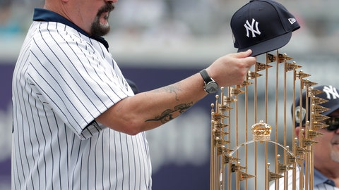 <p>               Former New York Yankees pitcher David Wells puts his hat on the 1998 World Series trophy during a ceremony honoring the team prior to a baseball game between the New York Yankees and the Toronto Blue Jays, Saturday, Aug. 18, 2018, in New York. (AP Photo/Julio Cortez)             </p>