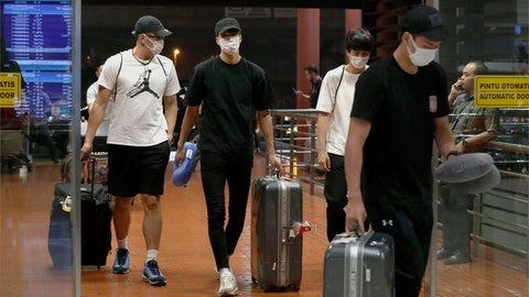 "<p>               Four Japanese basketball players arrive at Jakarta airport Monday, Aug. 20, 2018. They were kicked off their Asian Games team and sent home Monday after delegation head Yasuhiro Yamashita said they ""spent the night in a hotel with women."" Yamashita told a news conference that the four players hooked up with the women after eating and drinking and were easily identified by wearing Japan-emblazoned shirts in an entertainment district. (Jun Hirata/Kyodo News via AP)             </p>"
