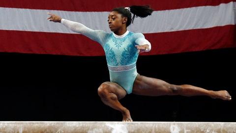<p>               Simone Biles competes on the balance beam at the U.S. Gymnastics Championships, Sunday, Aug. 19, 2018, in Boston. (AP Photo/Elise Amendola)             </p>