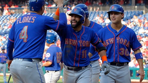 <p>               New York Mets' Jose Bautista, center, high-fives Wilmer Flores after Bautista hit a grand slam during the fifth inning of a baseball game against the Philadelphia Phillies, Thursday, Aug. 16, 2018, in Philadelphia. (AP Photo/Tom Mihalek)             </p>
