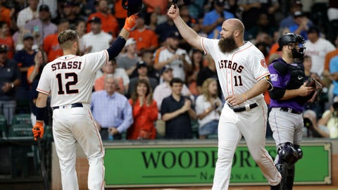<p>               Houston Astros' Evan Gattis (11) celebrates with Max Stassi (12) after hitting a home run during the fifth inning of a baseball game against the Colorado Rockies on Wednesday, Aug. 15, 2018, in Houston. (AP Photo/David J. Phillip)             </p>