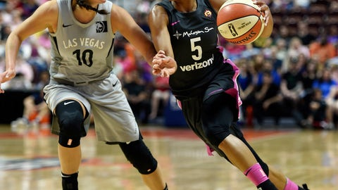<p>               Connecticut Sun guard Jasmine Thomas (5) drives past Las Vegas Aces guard Kelsey Plum (10) in the first half half of WNBA basketball game action Sunday, Aug. 5, 2018, in Uncasville, Conn. (Sean D. Elliot/The Day via AP)             </p>