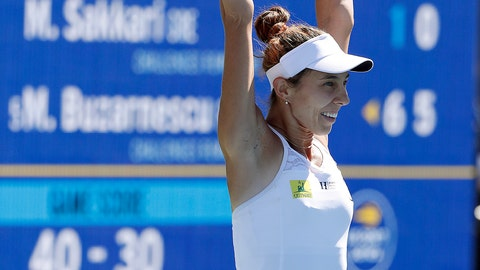 <p>               Mihaela Buzarnescu, of Romania, celebrates after defeating Maria Sakkari, of Greece 6-1, 6-0, during the finals of the Mubadala Silicon Valley Classic tennis tournament in San Jose, Calif., Sunday, Aug. 5, 2018. (AP Photo/Tony Avelar)             </p>