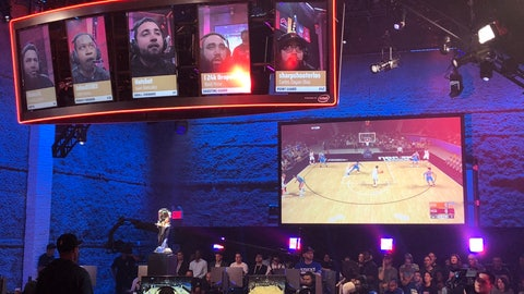 <p>               Heat Check Gaming players are seen on the screens above their seats while action from their game against Knicks Gaming is shown on another screen, Saturday, Aug. 25, 2018, in New York. The Knicks sweep the Heat to win the inaugural NBA 2K Finals. (AP Photo/Brian Mahoney)             </p>