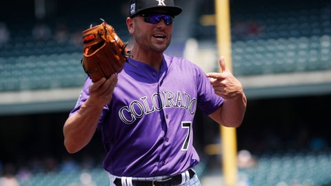 <p>               Colorado Rockies left fielder Matt Holliday points to his glove as he takes the field to face the San Diego Padres while signing autographs before a baseball game Thursday, Aug. 23, 2018, in Denver. (AP Photo/David Zalubowski)             </p>