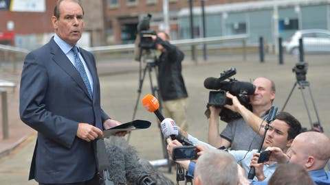 <p>               Former police chief Sir Norman Bettison speaks to the media outside Preston Crown Court, in Preston, England, Tuesday Aug. 21, 2018. Bettison who was charged with lying about his involvement in the aftermath of the Hillsborough Stadium tragedy in 1989 will no longer face trial. Bettison, who was chief inspector of the region where Britain's worst sports disaster took place, had been charged with four counts of misconduct while in public office.(Peter Powell/PA via AP)             </p>