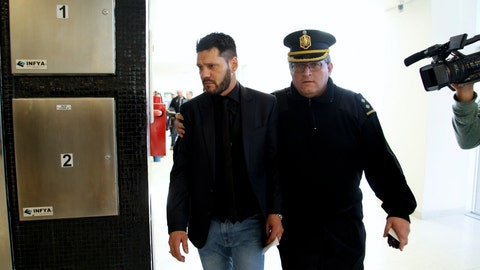 <p>               Matias Messi is escort outside the Criminal Justice Center in Rosario, Argentina Thursday, Aug. 16, 2018. One of Lionel Messi's brothers has been sentenced for illegally possessing a firearm, to two and a half years in prison. Matias Messi will not go to jail and was instead ordered to perform community service. (AP Photo/Alan Monzon)             </p>
